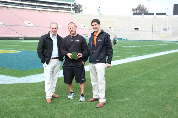 Troy Kuenzi, President of Mountain View Seeds (left), Will Schnell, Head Groundskeeper for The Rose Bowl (center) and Aaron Kuenzi, Executive Vice President for Mountain View Seeds (right) discuss the impressive tensile strength of the bluegrass sod sample taken from the Rose Bowl field.